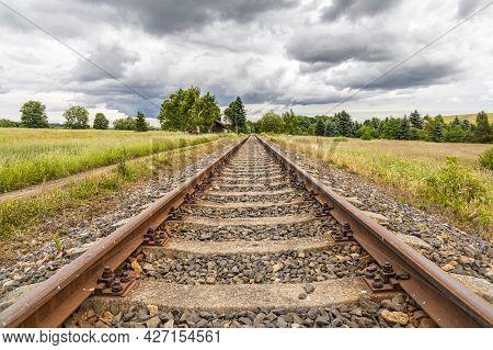 Symmetry Railway In Summer Countryside Under Cloudy Sky - Czech Republic, Europe.