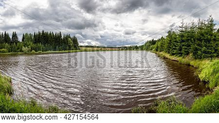 Pond In Summer Landscape And Forests Under Cloudy Sky - Czech Republic, Europe