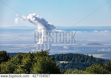 Lignite Power Plant Called Tusimice With Column Of Smoke Under Blue Sky - Czech Republic, Europe
