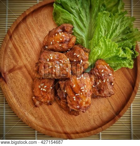 Ayam Wijen. Chicken Cooked With Sesame And Sour Spice