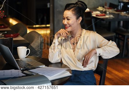 Happy Elegant Businesswoman Watching Webinar Or Attending Online Meeting With Colleagues
