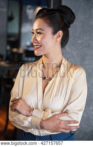 Portrait Of Smiling Beautiful Business Lady Crossing Arms And Looking Away When Standing In Her Rest
