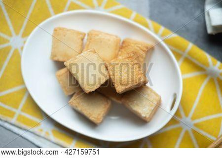 Close Up Of Diced Fish Tofu On White Dish