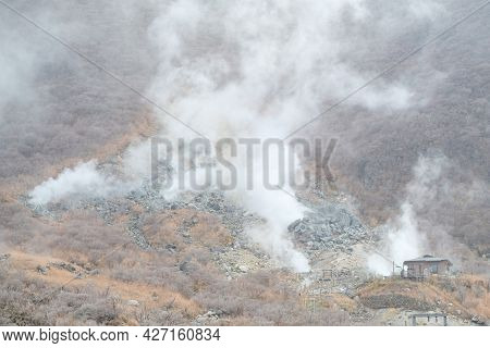 Small House On Kami Mountain With Smoky Around Area In Owakudani Hell Valley , Hakone Boiling Steam