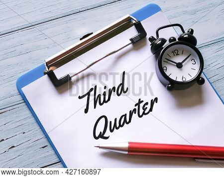 Business And Finance Concept. Selective Focus Paper Clipboard Written Third Quarter With Pen And Eye