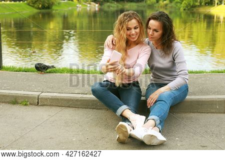 lifestyle, family and people concept - Mother With Adult Daughter In Park Together