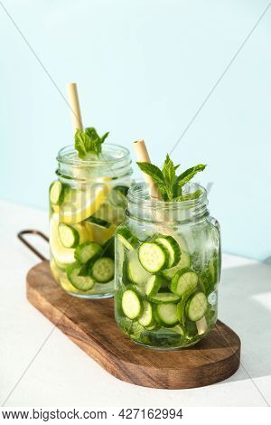 Detox Infused Water. Refreshing Homemade Cocktails Summer Drinks, Selective Focus