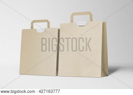 Paper shopping bags on gray background