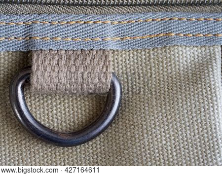 A Metal Buttonhole Is Sewn To The Thick Fabric. Fabric, Texture.