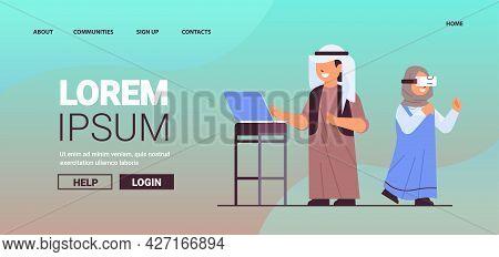 Arab Schoolboy Using Laptop Schoolgirl Wearing Vr Headset Smiling Girl In Digital Glasses Exploring