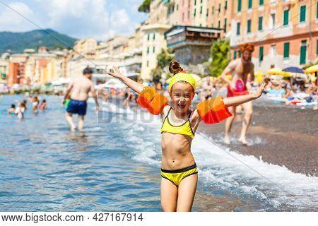 Little Girl On The Beach In Italy, Coast In Italy