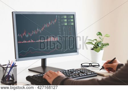 Businessmen Work With Stock Market Investments Using Laptops To Analyze Trading Data. Desktop Comput