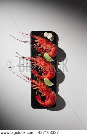 Three Cooked Royal Prawns With Lime, Garlic And Herbs