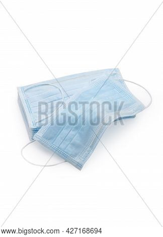 Blue Protective Face Mask. Disposable Medical Face Mask Isolated On White Background Closeup. Covid-