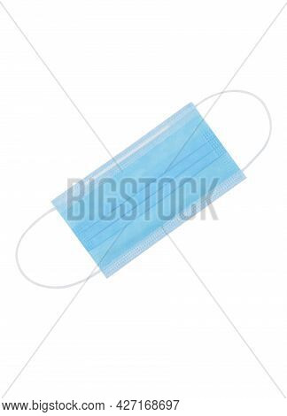 White Protective Face Mask. Disposable Medical Face Mask Isolated On White Background Closeup. Covid