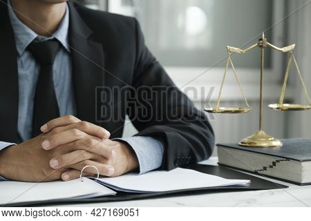 Male Lawyer In The Office With Brass Scale.