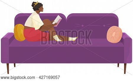 Girl Sits At Home And Reads. Woman With Book In Her Hands Spending Time In Apartment. Female Charact