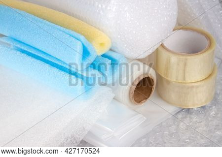 Set Of Plastic Packaging Materials - Plastic Stretch Film Rolls, Foamed Polyethylen Sheets And Rolls