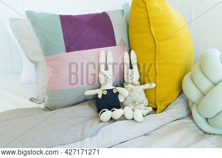 Cozy Children\'s Bedroom In Colourful Pillows With Many Animal Dolls Lying On The Bed