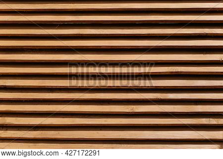 Wooden Fence Made Of Horizontal Thin Boards. Textured Brown Fence Background, Wood Panels Pattern, O