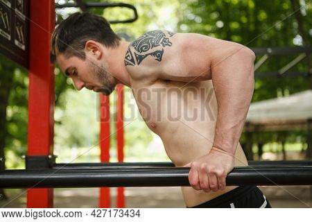 Close Up Of A Handsome Sportsman Doing Triceps Dips On Calisthenics Playground