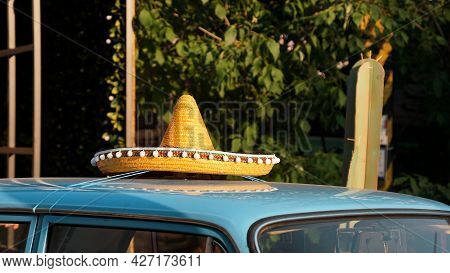 Roof Of A Blue Retro Car. Mexican Hat On The Roof Of The Car. Exhibition Of Retro Cars