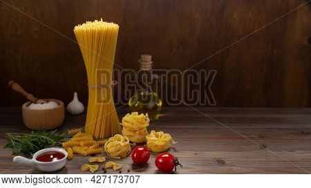 Pasta and food ingredient on wooden table background. Raw pasta italian food at tabletop