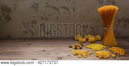 Pasta collection food on wooden table background. Raw pasta italian food at tabletop