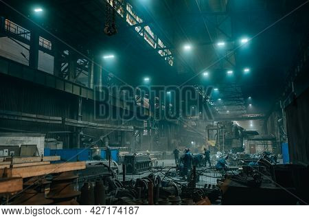 Industrial Workshop Or Warehouse With Steel Goods And Workers On Metallurgical Factory.