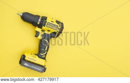 Stanley's New Cordless Screwdriver On A Yellow Background.