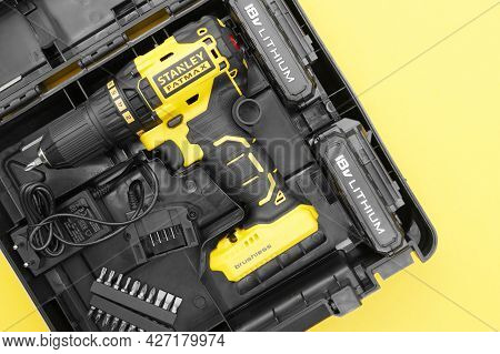 Stanley's New Cordless Screwdriver In A Box On A Yellow Background .