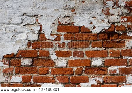 Red And White Brick Background. Dilapidated Brick Wall. Grunge Texture Is Red Brick. White Old Plast