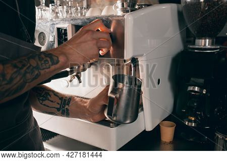 Barista Shaking Milk For Invigorating Drink, Sweet Cappuchino Or Latte. Close Up Image