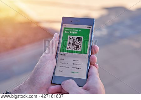 Man Holding Smartphone Displaying On App Mobile Negative Covid-19 Express Test Results. Immunity Vac