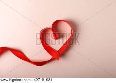 Heart From Red Ribbon On Pink Desk Background. Concept Valentines Day, Date Planning, February 14, R