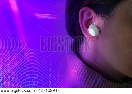 Musical gadget innovation woman with wireless earphones entertainment technology remixed media