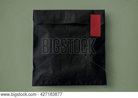 Black snack paper bag packaging corporate identity design