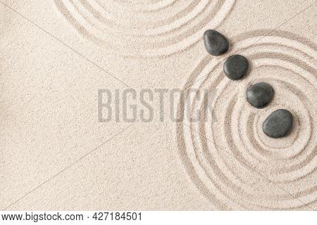 Zen stones sand background health and wellness concept