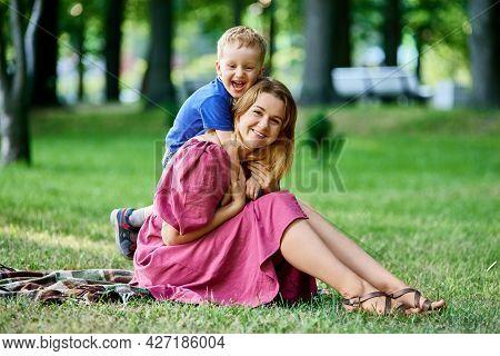 Cheerful Little Boy 3 Years Old Hugs Mom.