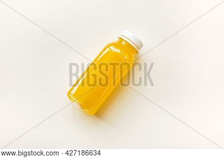 Bottles Of Freshly Squeezed Orange Juice On A White Background. The Concept Of A Healthy Diet, Detox
