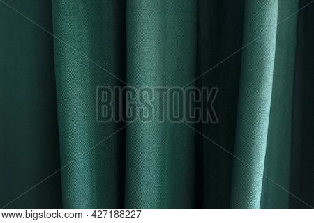 Closeup of green textile with pleats