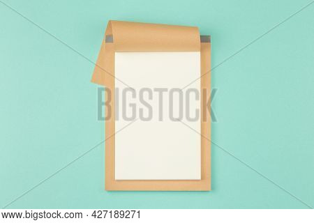 Open Notebook On Isolated Cyan Background. Open Craft Album. Top View.