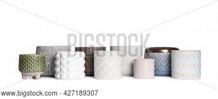 Different Stylish Ceramic Flowerpots On White Background