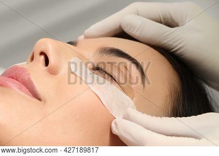 Young Woman Undergoing Eyelash Lamination, Closeup. Professional Service