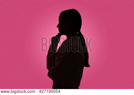Silhouette Of Anonymous Woman On Pink Background