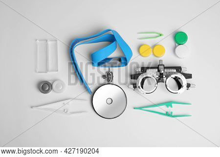 Different Ophthalmologist Tools On White Background, Flat Lay
