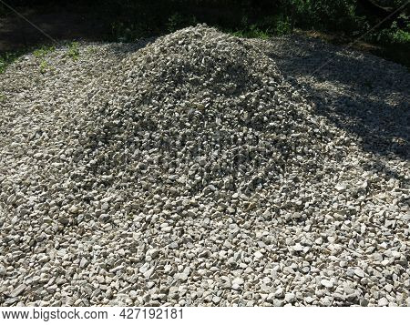 Pile Of Small Rubble, Gravel Lies On The Road, An Industrial Background