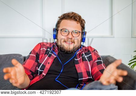 Photo Of A Smiling Young Man In Headset During Online Video Call.