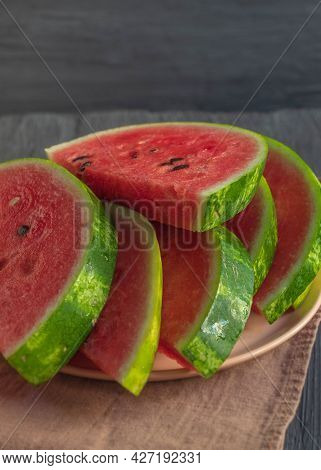 The Photo Shows A Picture Of Fresh And Juicy Food. These Are Watermelon Slices With Dark Seeds. Slic