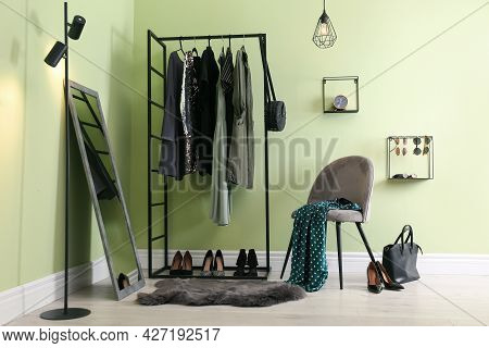 Modern Dressing Room Interior With Clothing Rack, Chair And Mirror